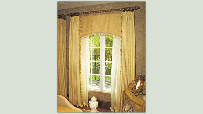 Valances can help solve architectural problems by giving the illusion of a different window size