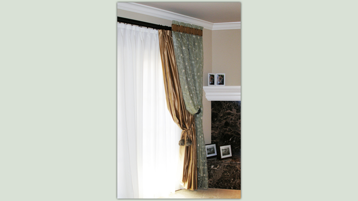 Operating sheers and draperies layered under stationary side panels allow for tremendous versatility